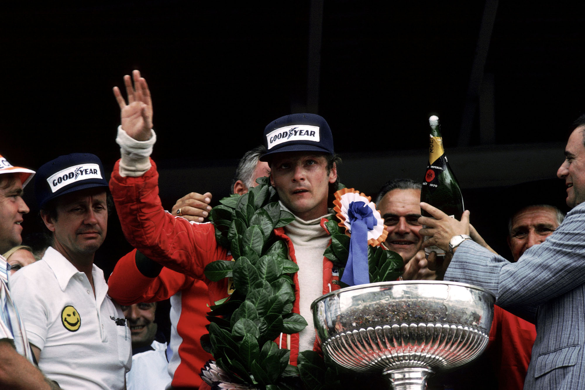 Niki Lauda (Ferrari) waves to the crowd after winning the 1977 South African Grand Prix.