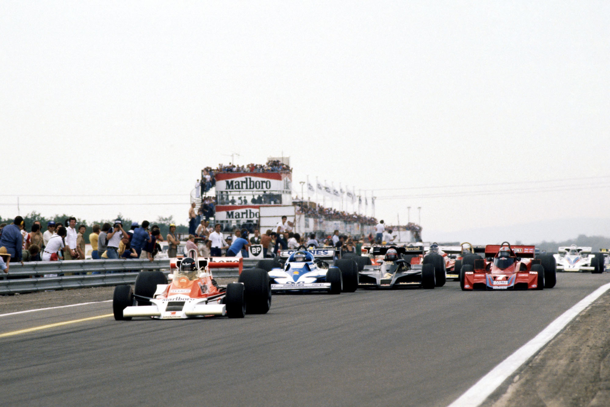 James Hunt (McLaren) leads at the start of the 1977 French Grand Prix, Dijon.