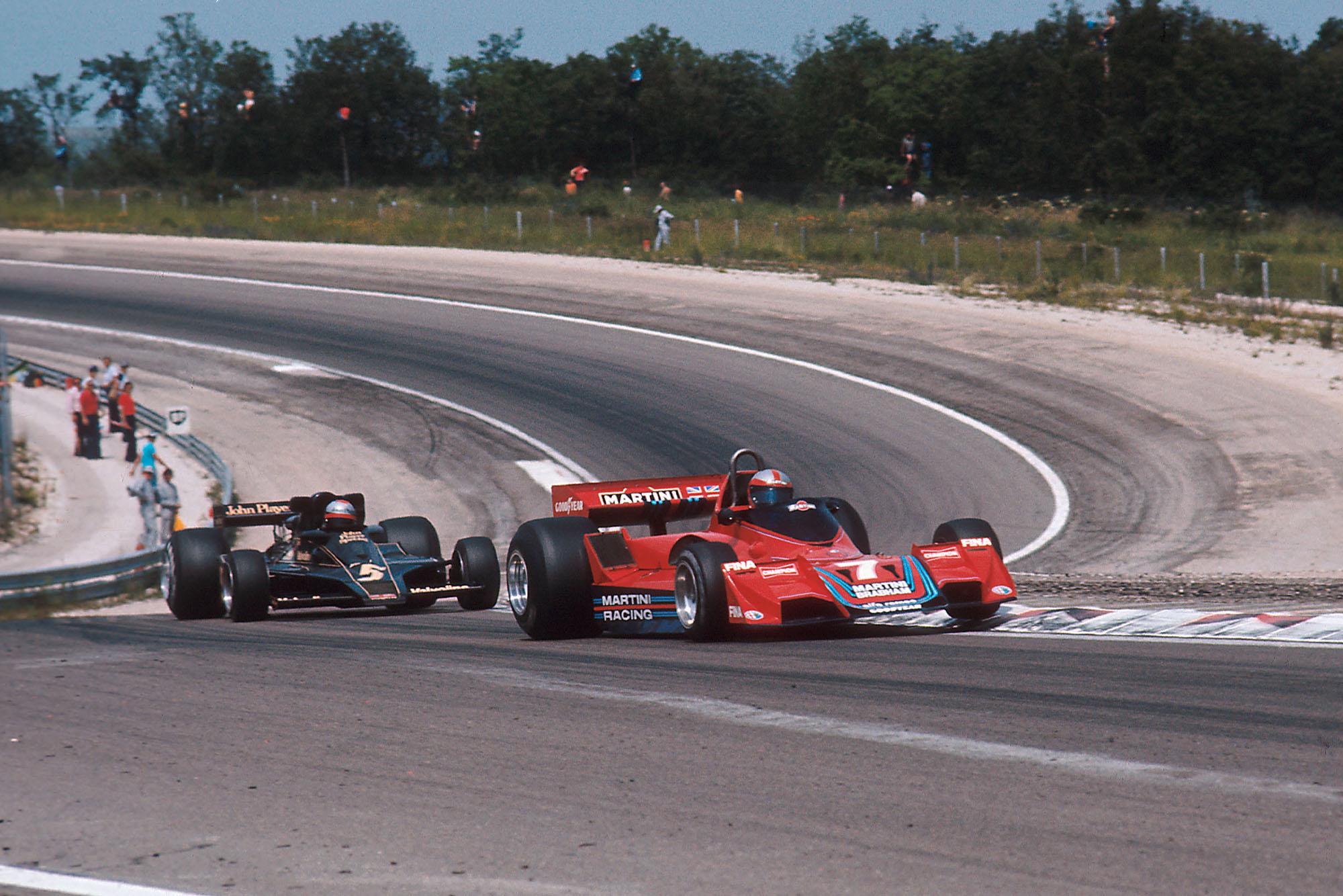 John Watson (Brabham) leads Mario Andretti (Lotus).