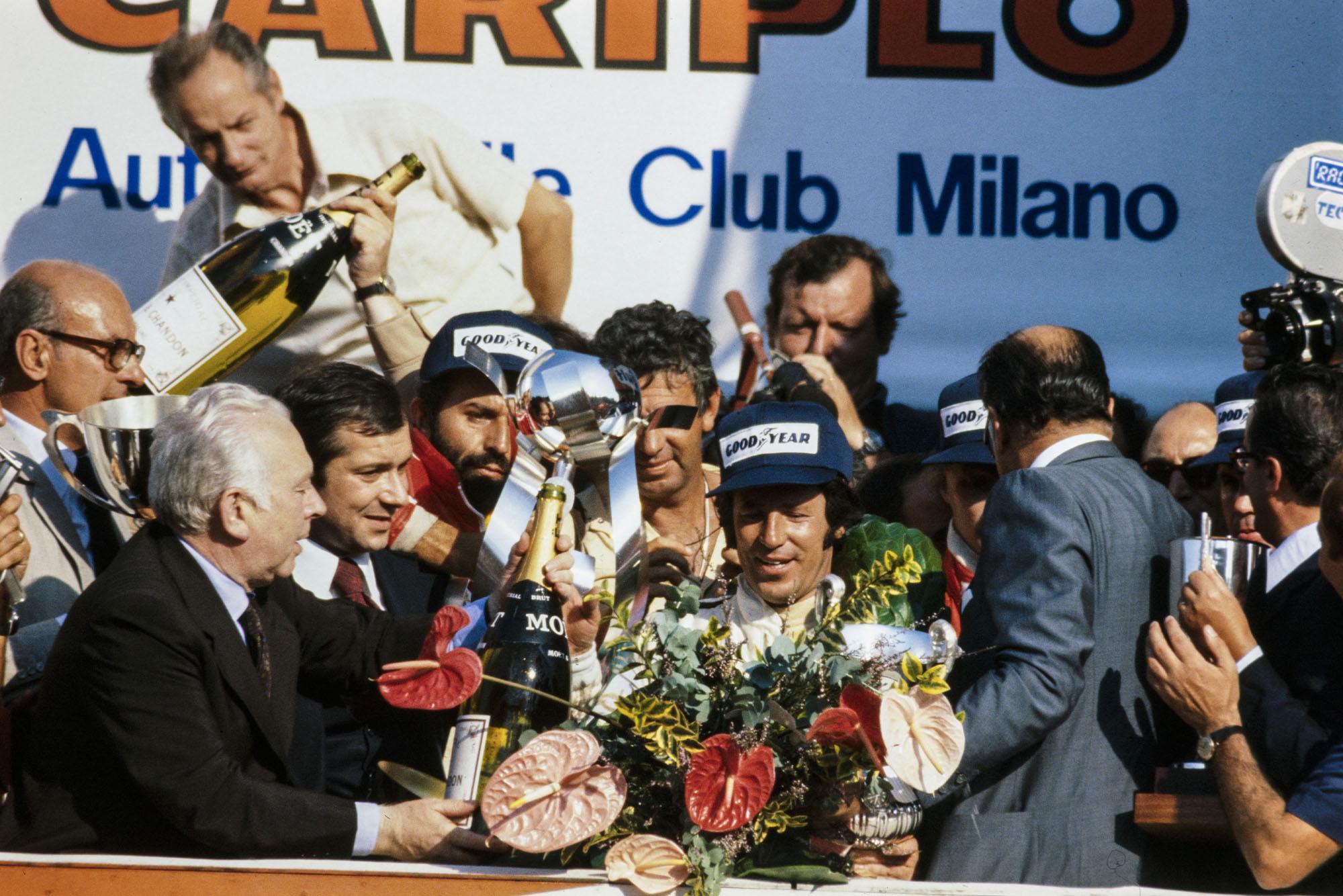 Mario Andretti (Lotus) celebrates winning the 1977 Italian Grand Prix, Monza.
