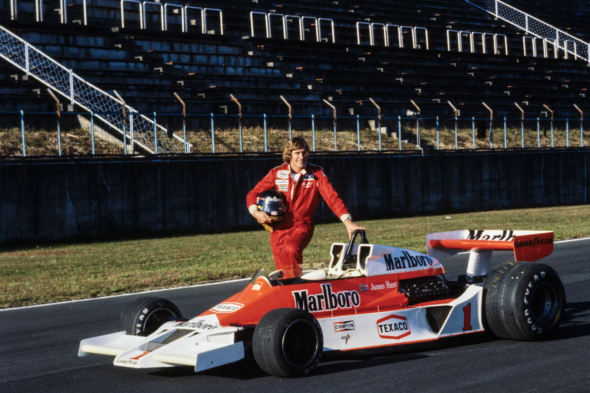 James Hunt poses with his McLaren at the 1977 Japanese Grand Prix, Fuji.