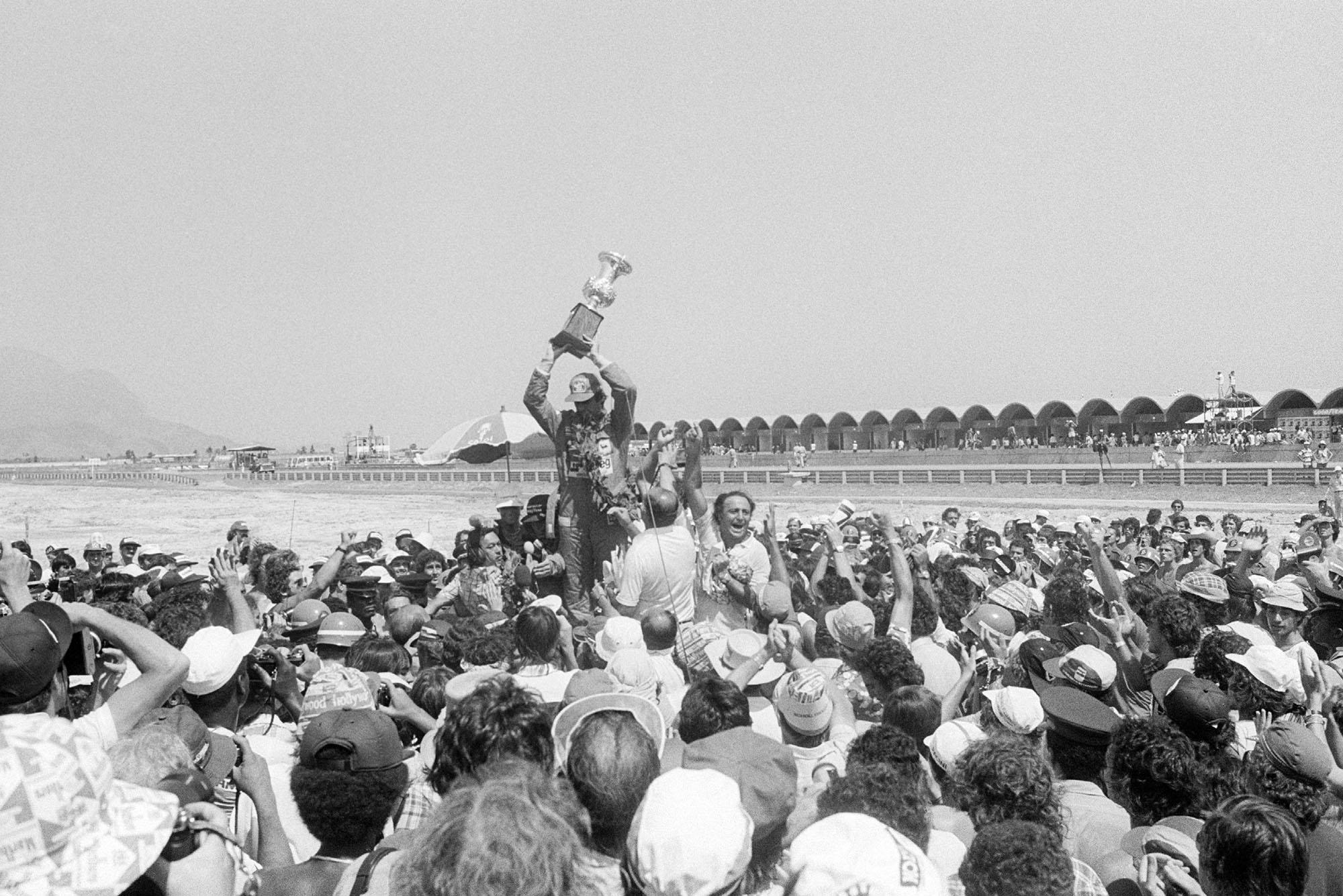 Carlos Reutemann (Ferrari) celebrates winning the 1978 Brazilian Grand Prix, Jacarepagua.
