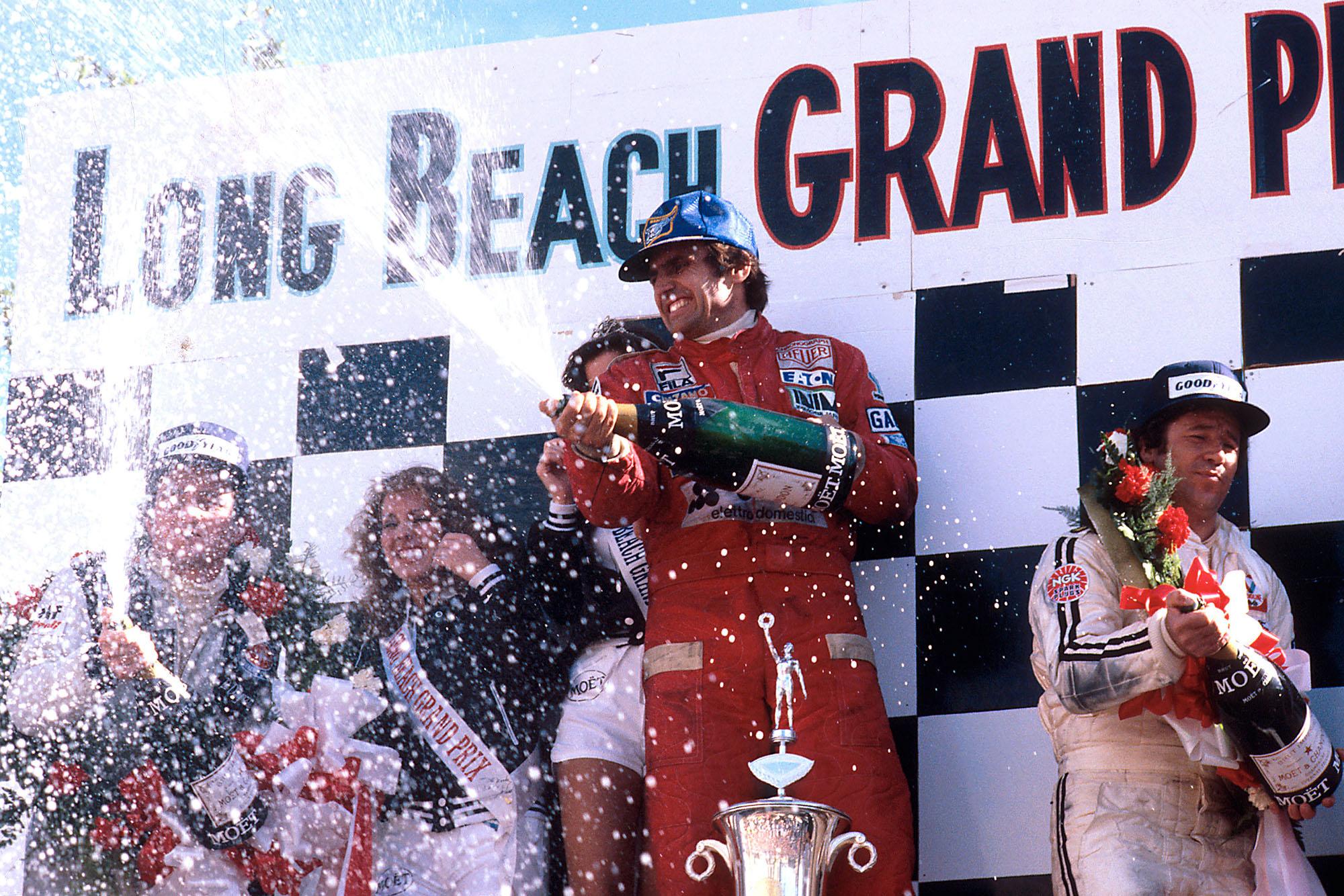 Carlos Reutemann (Ferrari) sprays champagne on the podium at the 1978 United States Grand Prix West, Long Beach.