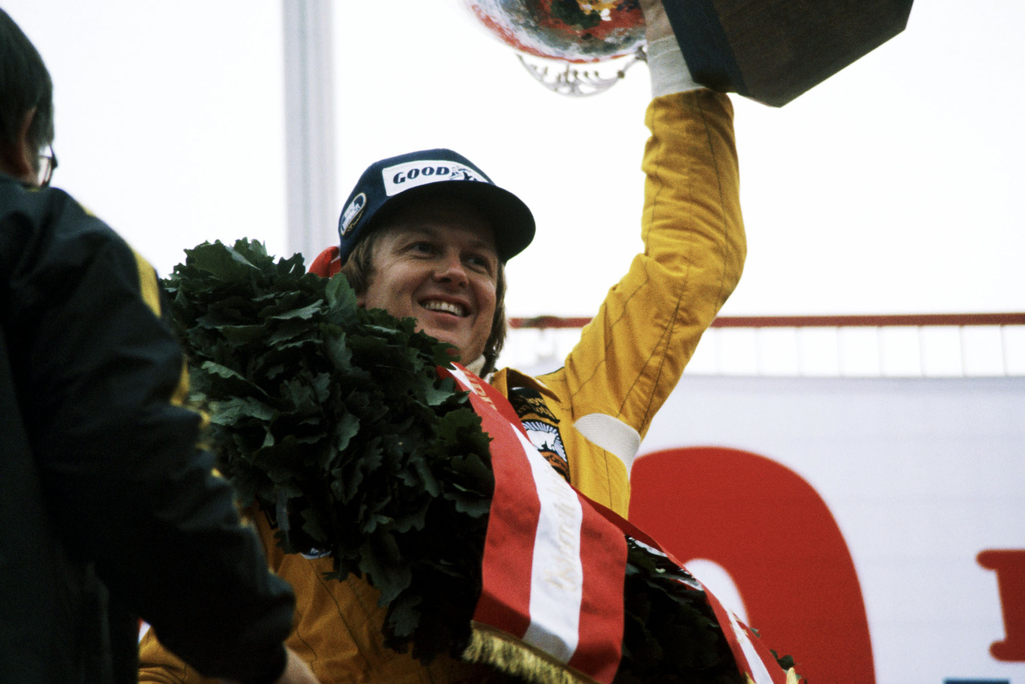Ronnie Peterson celebrates on the podium after winning the 1978 Austrian Grand Prix, Österreichring.