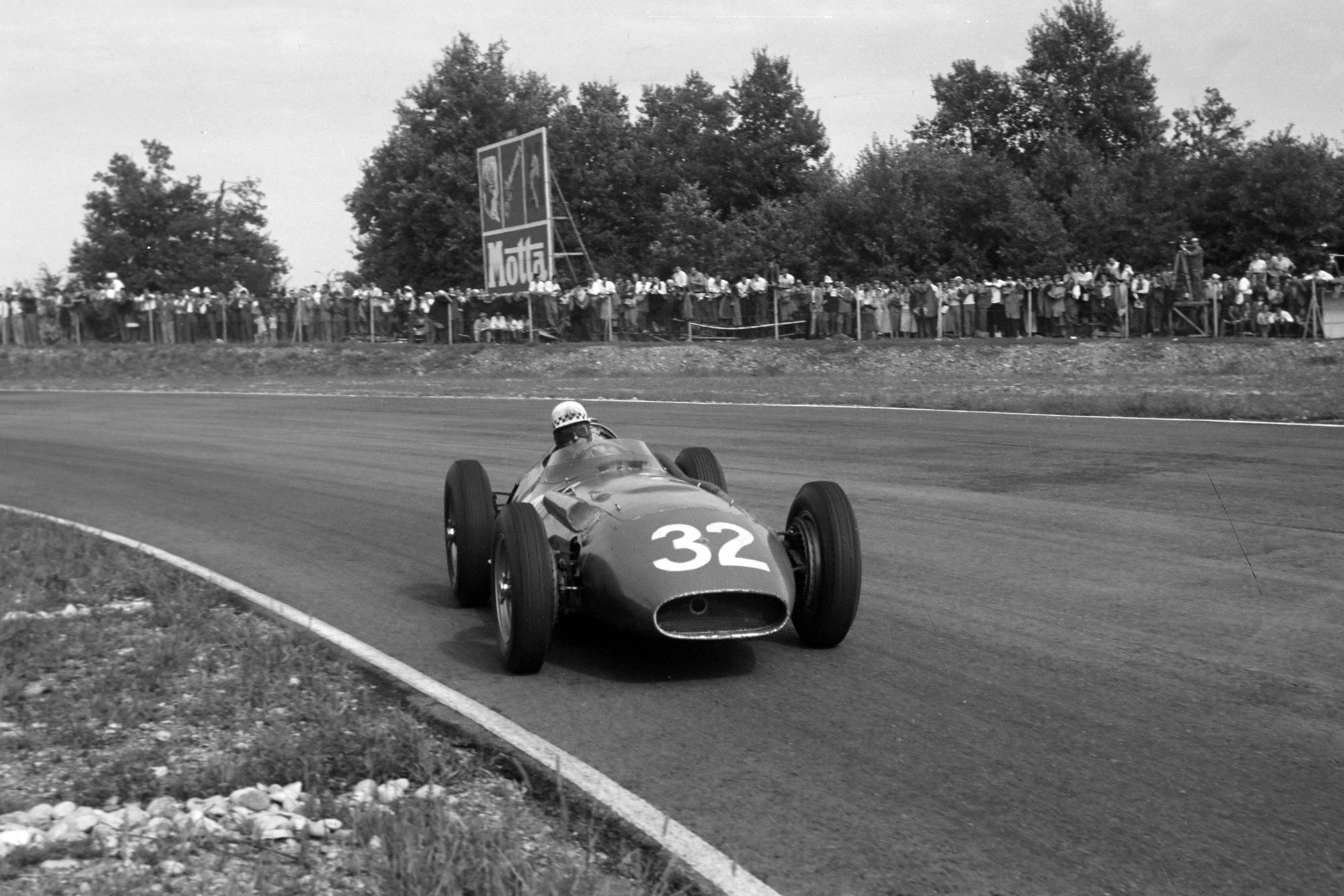 Jean Behra rounds the Curva Sud in his Maserati 250F, 1956 Italian Grand Prix, Monza.