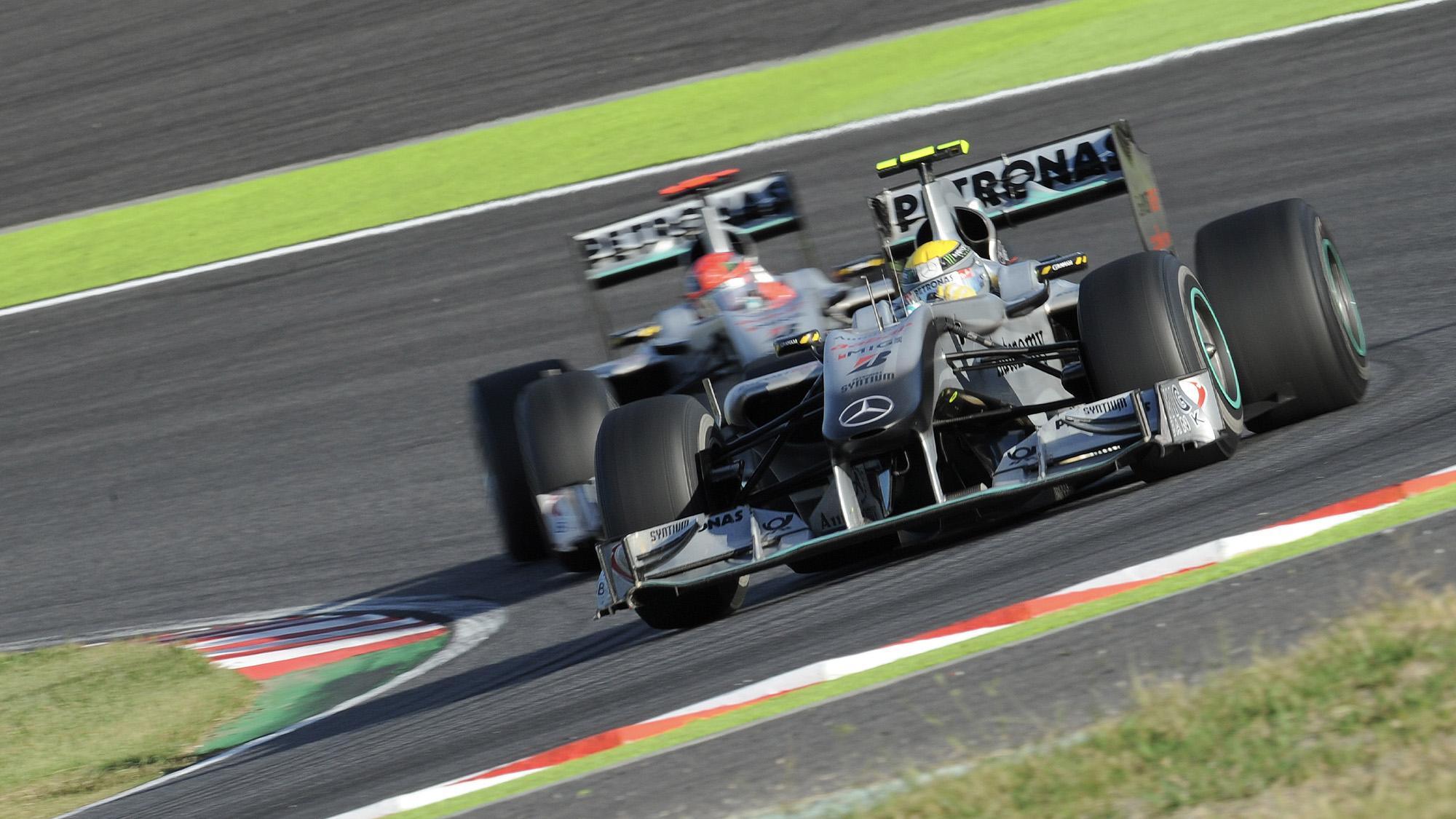 Nico Rosberg leads Mercedes team-mate Michael Schumacher at Suzuka in the 2010 Japanese Grand Prix