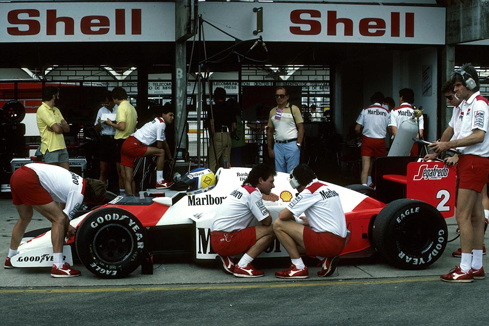 Keke Rosberg's McLaren MP4/2C in the pit garage.