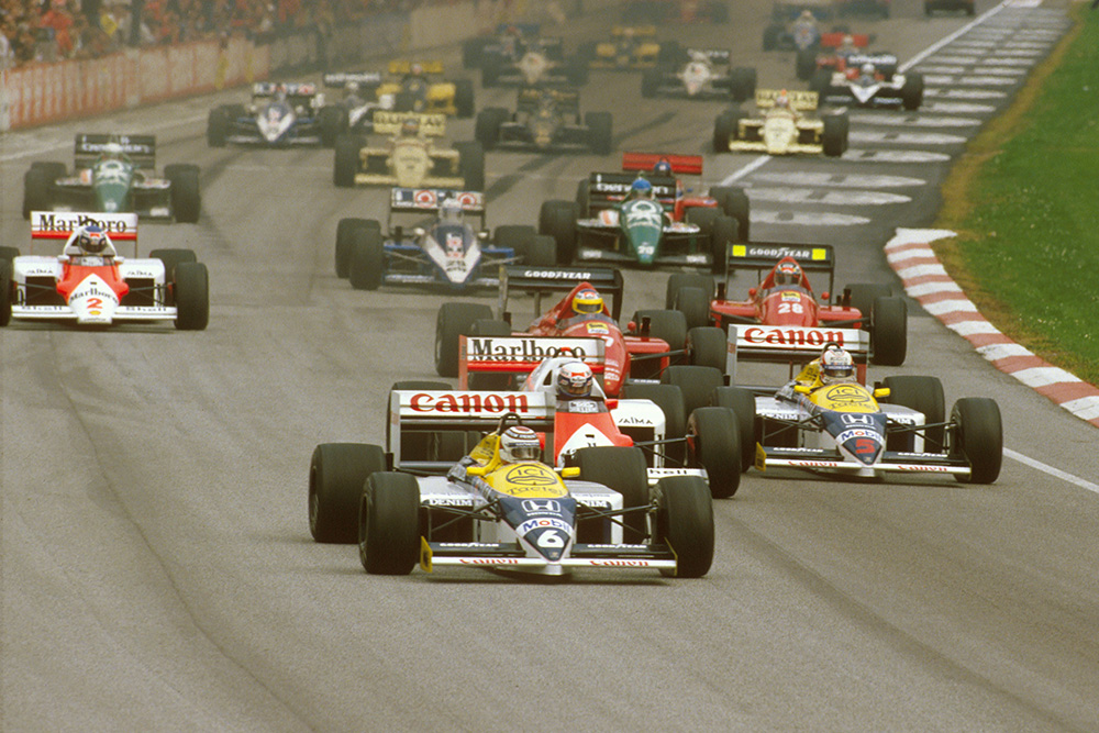 Nelson Piquet (Williams FW11 Honda) leads Alain Prost (McLaren MP4/2C TAG Porsche), Nigel Mansell (Williams FW11 Honda), Michele Alboreto and Gerhard Berger (both Ferrari F186's) at the start.