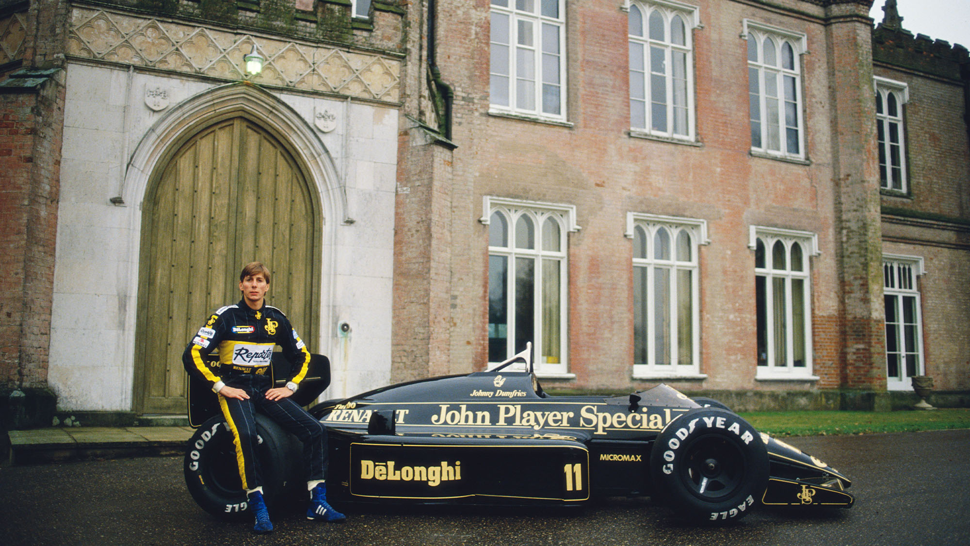 Racing driver Johnny Bute ,Marquess of Bute aka Johnny Crichton-Stuart and Johnny Dumfries drives poses with the John Player Special Lotus-Renault 98Tat Ketteringham Hall the home of Lotus cars January 1986 at Ketteringham Hall in Ketteringham, Great Britain. (Photo by Simon Miles/Getty Images)