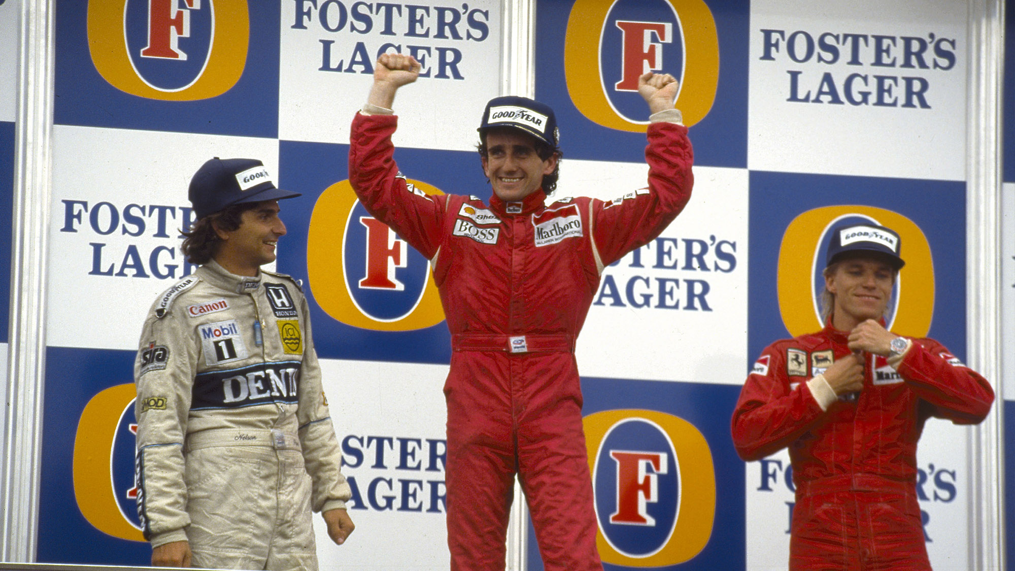 Alain Prost stands on the top of the podium at Adelaide after winning the 1986 Australian Grand Prix and that year's Formula 1 Drivers' championship