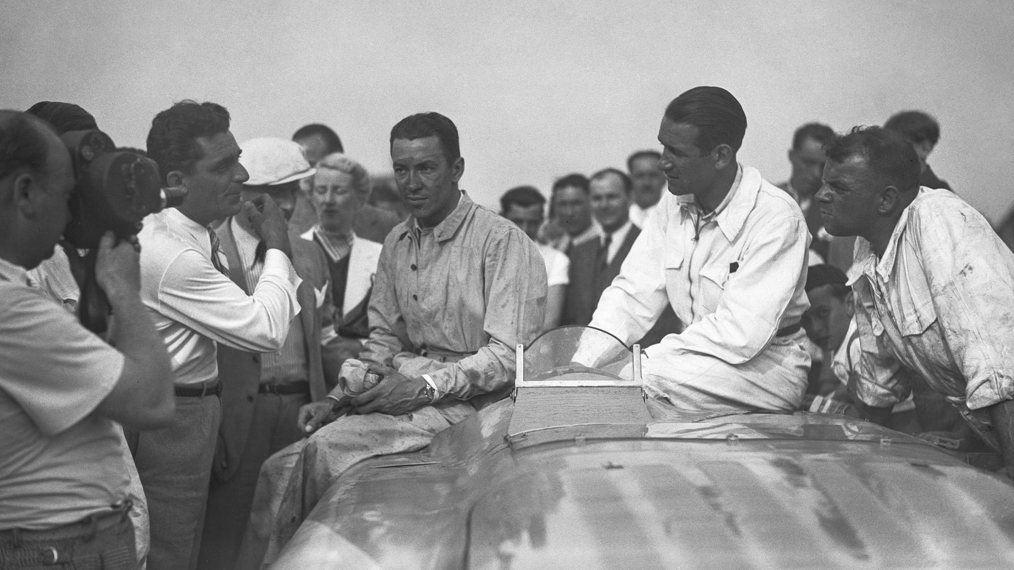 Jean-Pierre Wimille and Raymond Sommer after winning at Montlhery in 1936