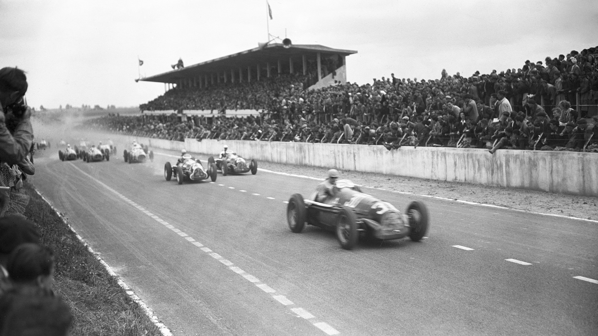 Jean-Pierre Wimille leads in his Alfa Romeo 158 at Reims-Gueux in 1948