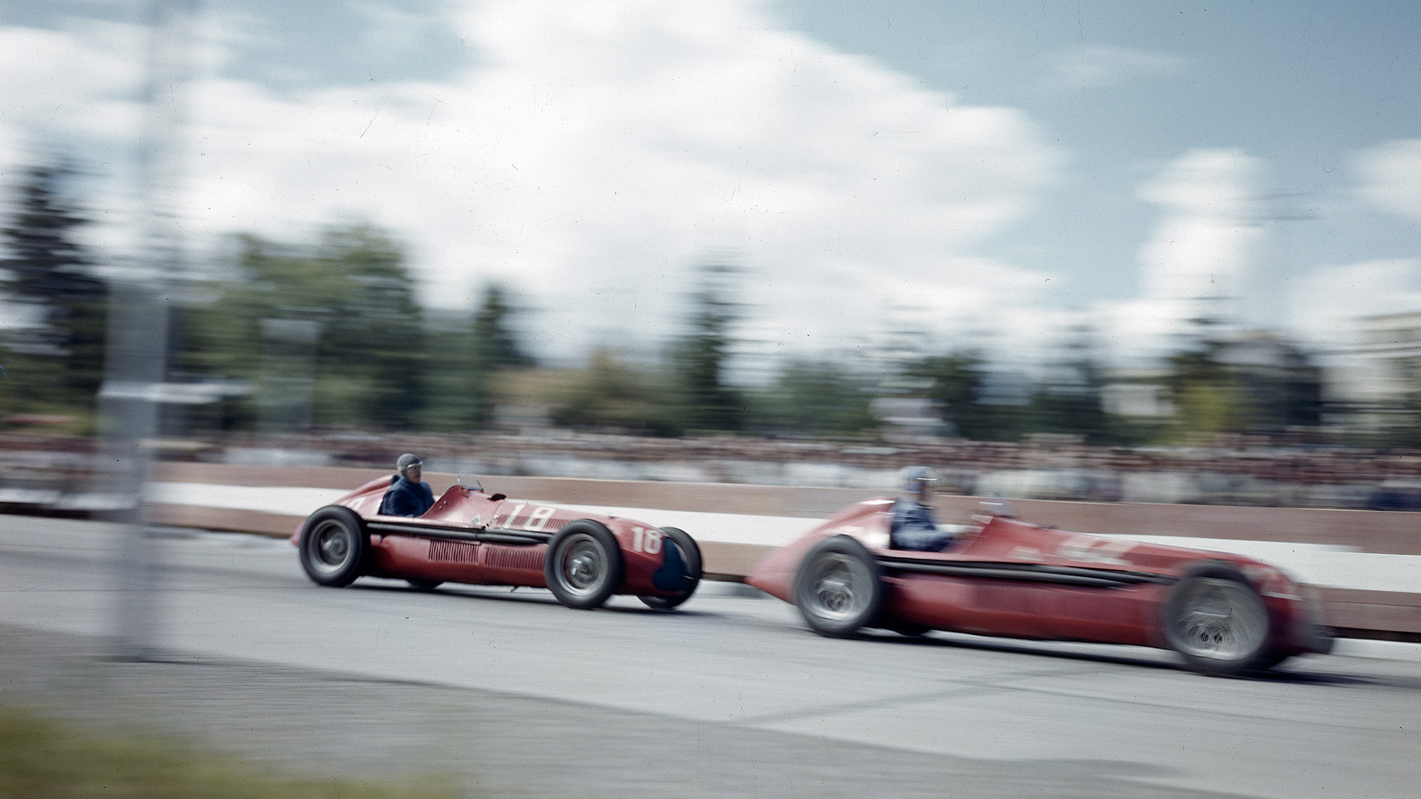 Jean-Pierre Wimille leads Alfa romeo 158 team-mate Giuseppe Farina at the 1946 Grand Prix des Nations in Geneva