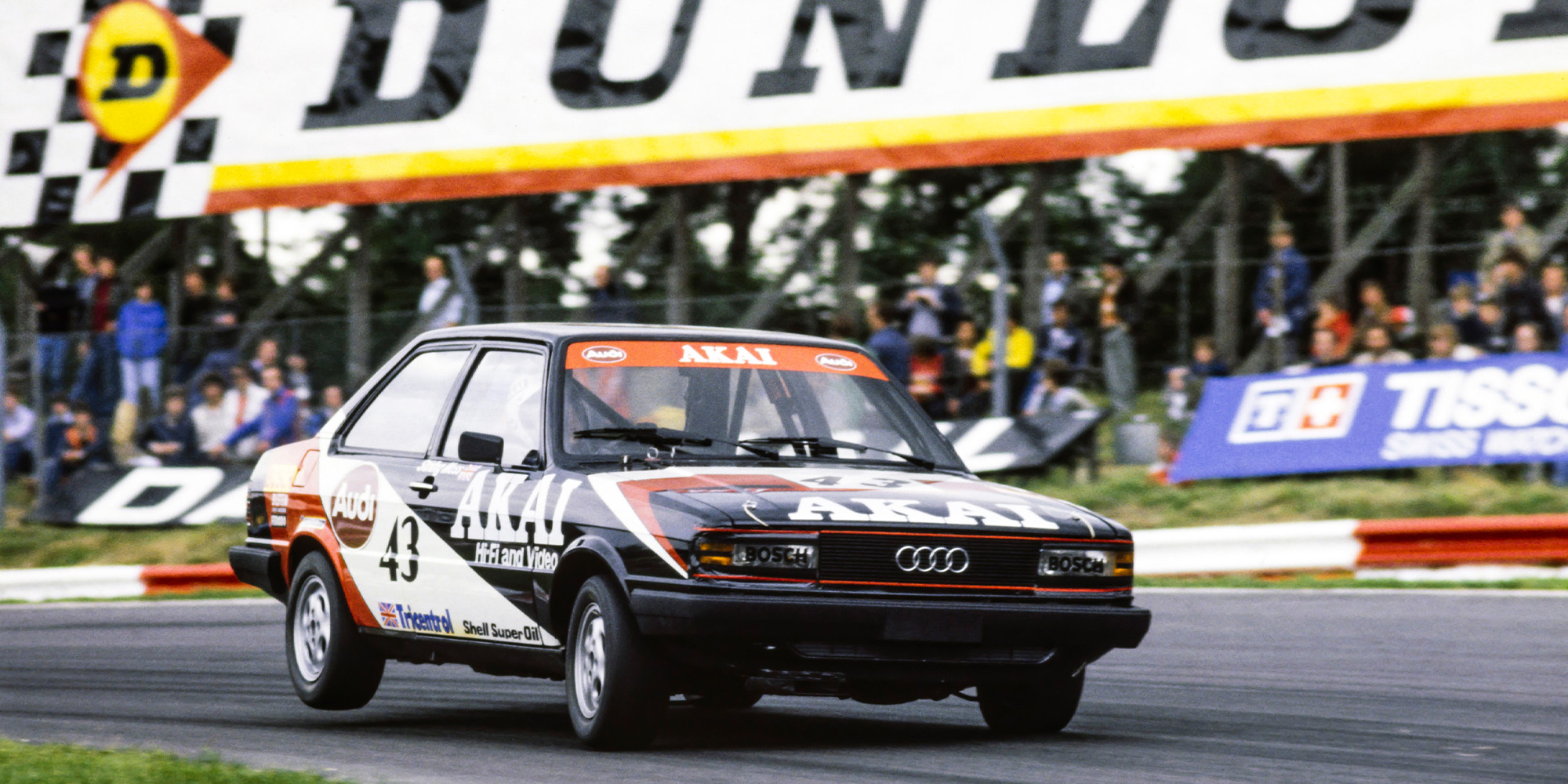 Stirling Moss' Audi lifts a wheel in the British Saloon Car Championship