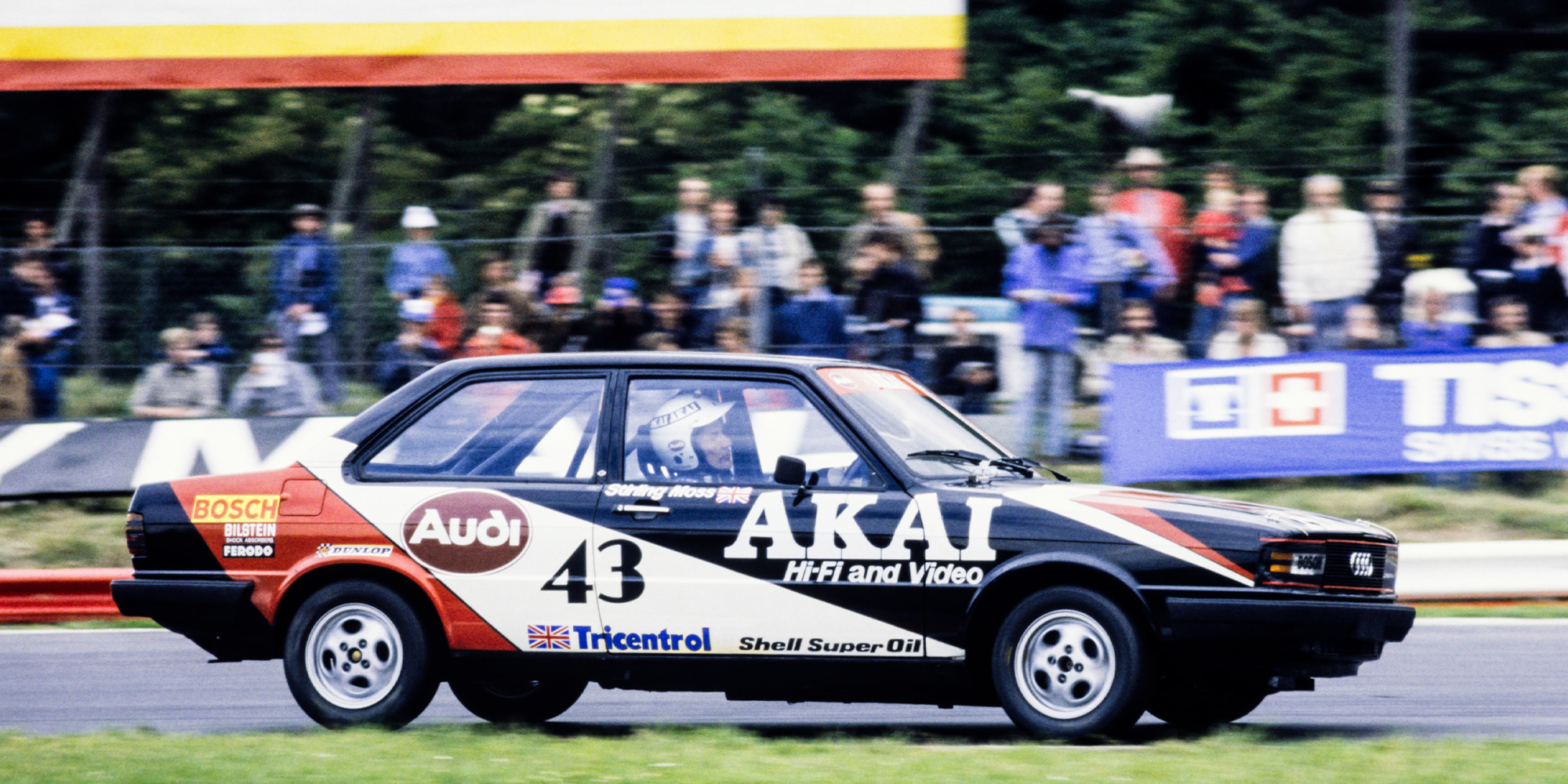 Stirling Moss behind the wheel of his Audi 80 in the British Saloon Car Championship