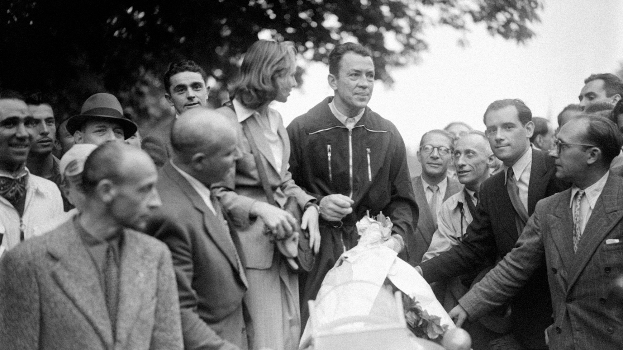 Jean-Pierre Wimille after winning at the Bois de Boulogne in 1945