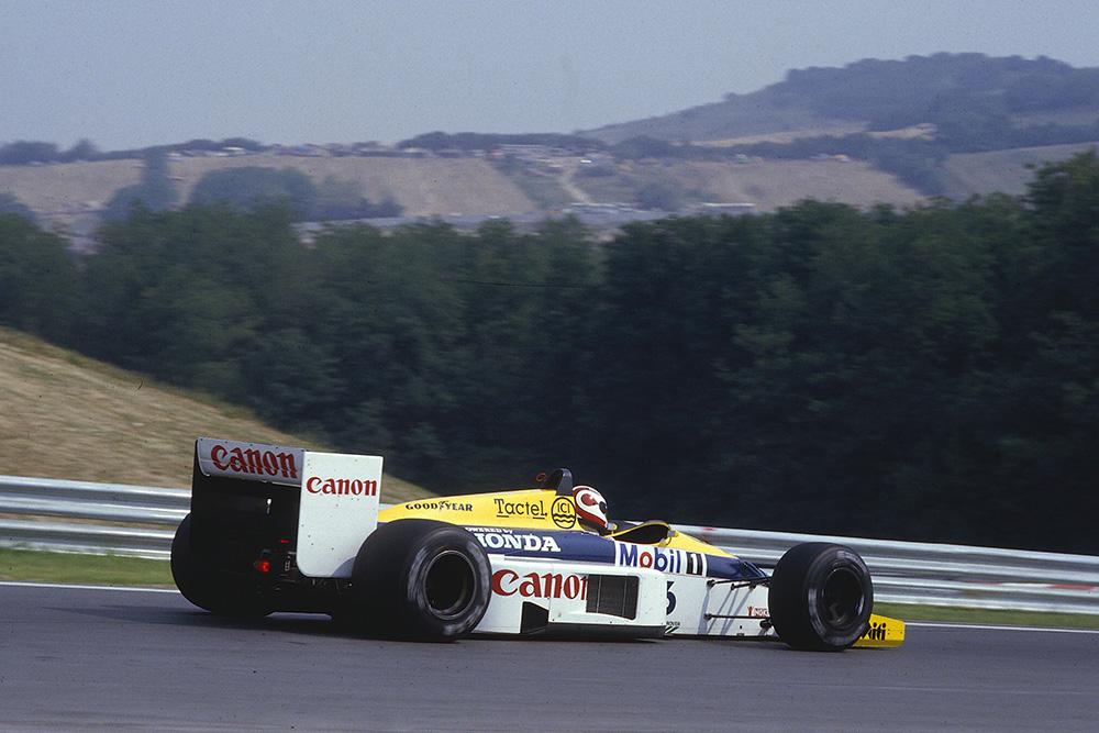Nelson Piquet driving his Williams FW11 Honda.