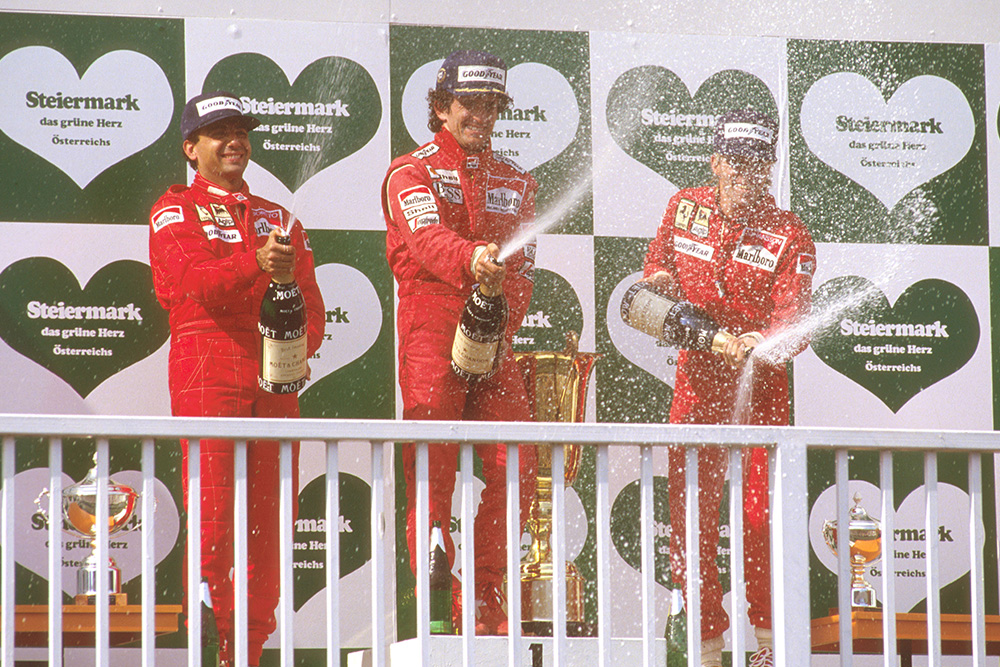 Alain Prost, 1st position, Michele Alboreto, 2nd position and Stefan Johansson, 3rd position on the podium.