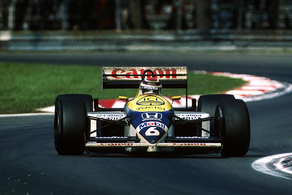 Race winner Nelson Piquet driving his Williams FW11.