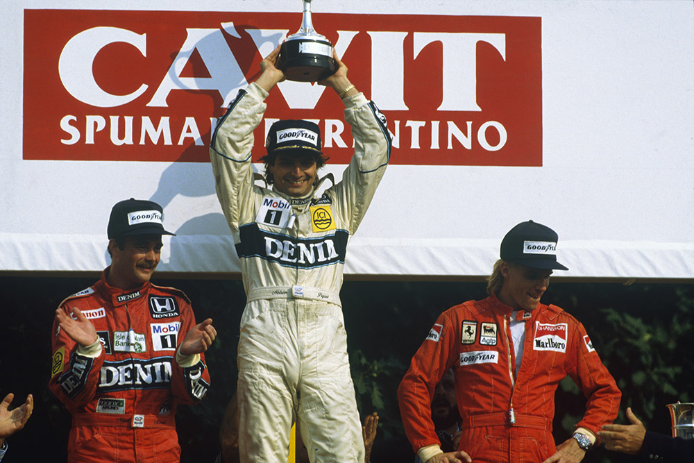 Nelson Piquet, 1st position, Nigel Mansell, 2nd position and Stefan Johansson 3rd position on the podium.