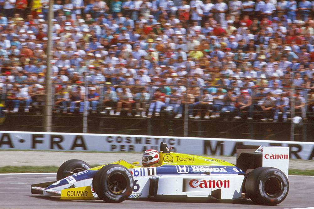 Nelson Piquet leads in his Williams FW11 Honda.