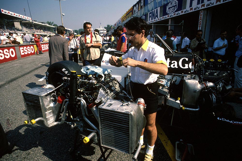 The Tyrrell mechanics set to work on their engines.
