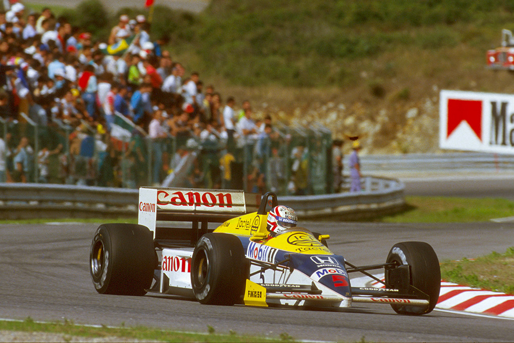 Nigel Mansell at the wheel of his Williams FW11 Honda.