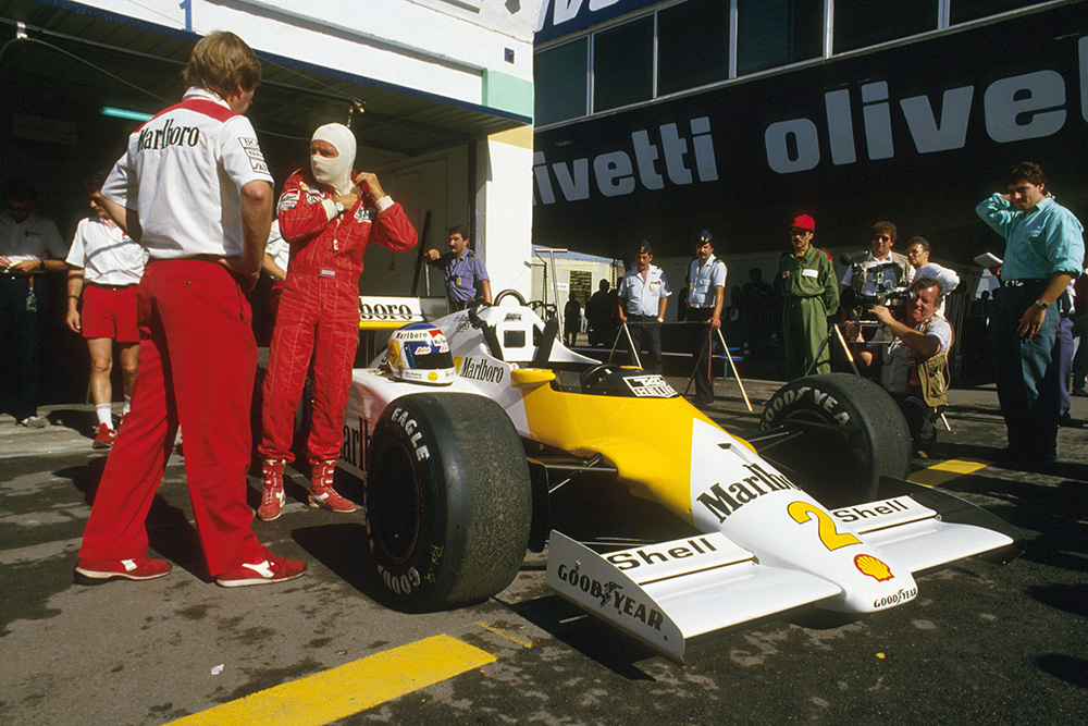 Keke Rosberg and his McLaren MP4/2C TAG Porsche in the pits.