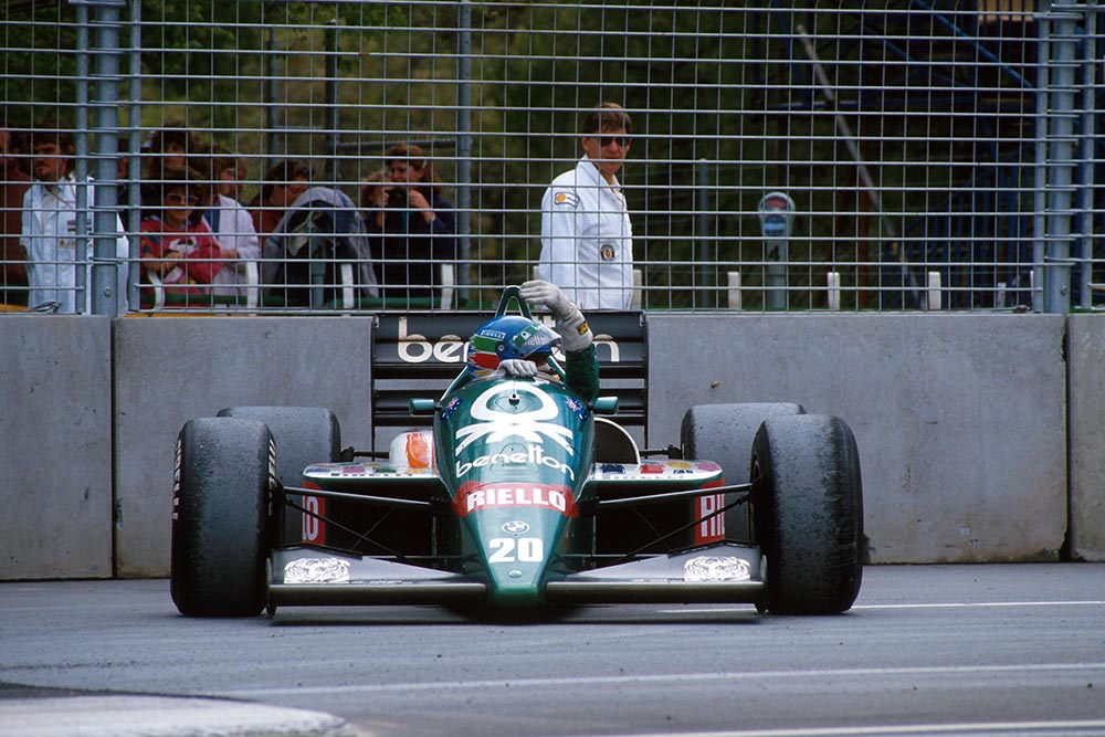 Gerhard Berger sits beside the track in his Benetton BMW4.