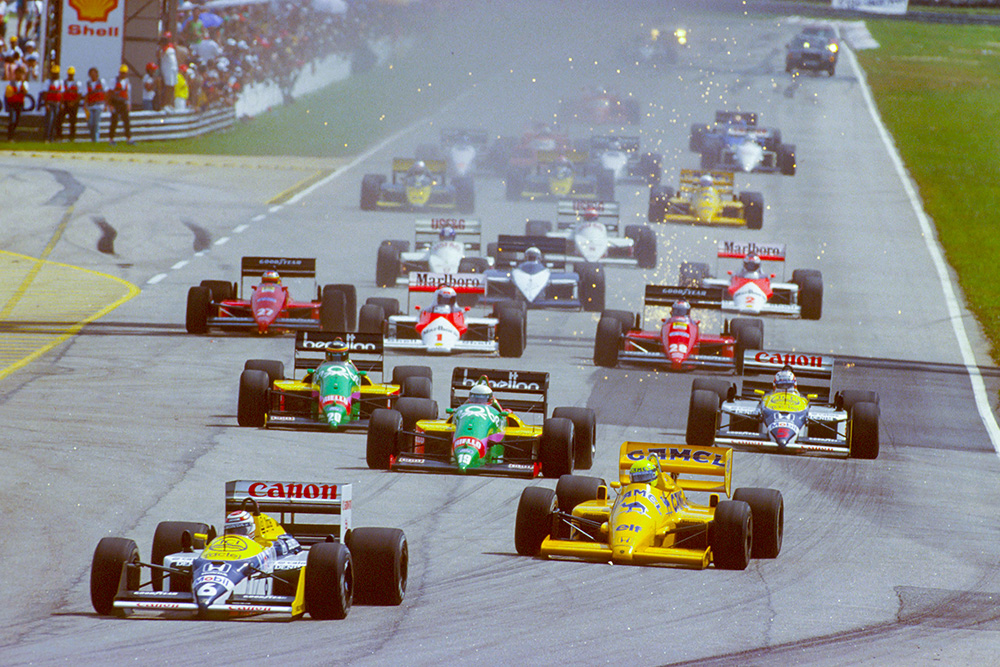 Nelson Piquet (Williams FW11B Honda) leads Ayrton Senna (Lotus 99T Honda), Teo Fabi and Thierry Boutsen (both Benetton B187 Ford's) and Nigel Mansell (Williams FW11B Honda) at the start.