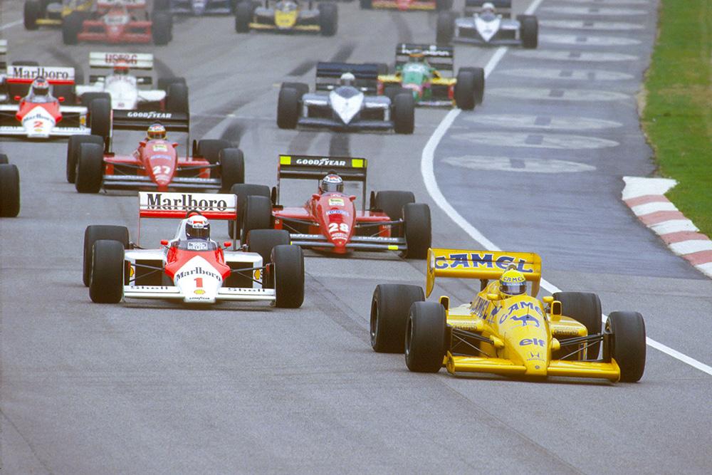 Ayrton Senna (Lotus 99T Honda) leads Alain Prost (McLaren MP4/3 TAG Porsche) and Gerhard Berger (Ferrari 187) at the start.