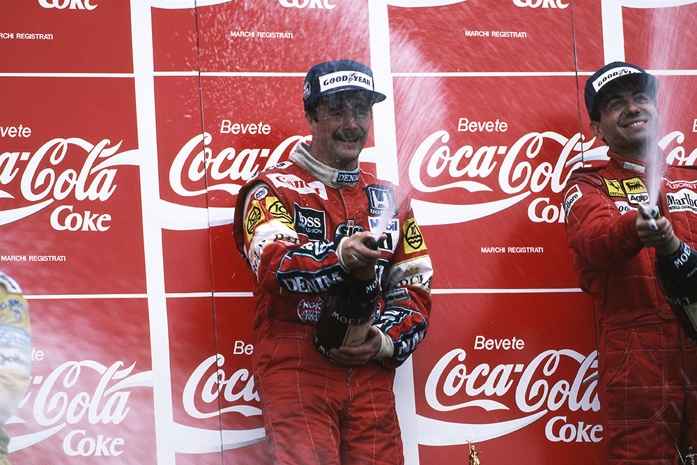 Race winner Nigel Mansell sprays the Champagne with third placed Michele Alboreto.
