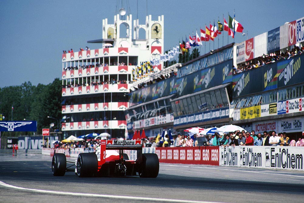 Stefan Johansson in his McLaren MP4-3, passes the Imola pits on his way to 4th place.