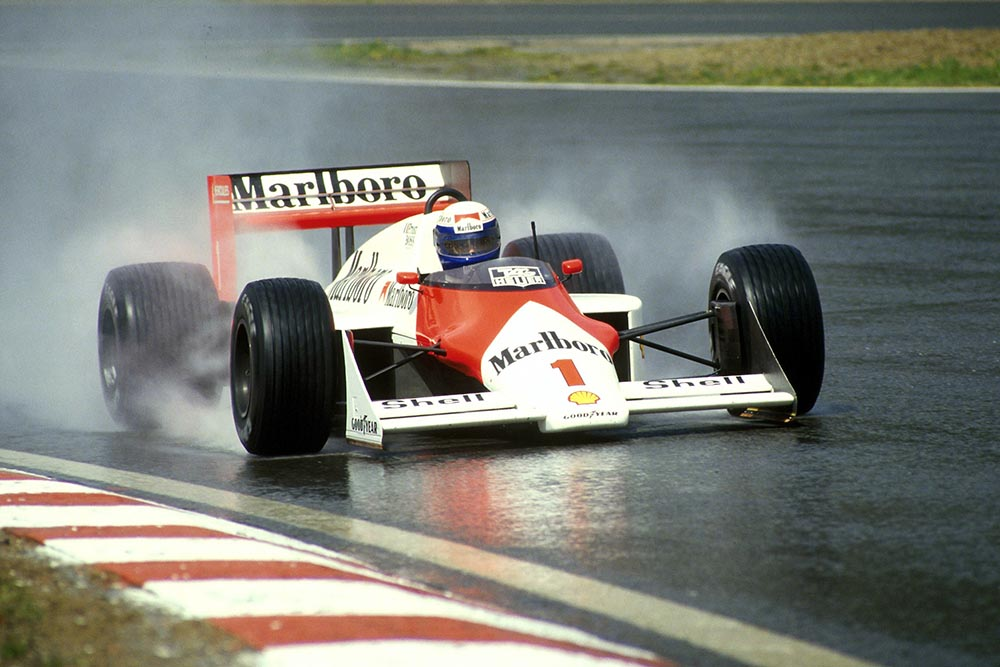 Winner Alain Prost charges through the rain in his Mclaren MP4-3.