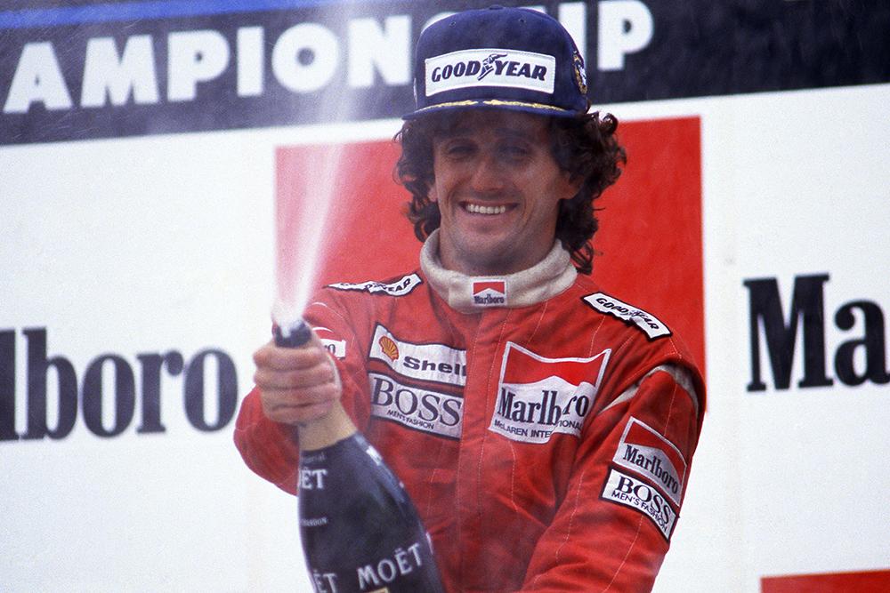 Race winner Alain Prost celebrates after equalling Jackie Stewarts record number of twenty-seven wins.