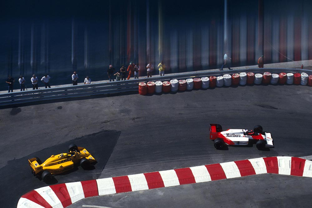 Alain Prost (Mclaren MP4/3) leads race winner Ayrton Senna (Lotus 99t).