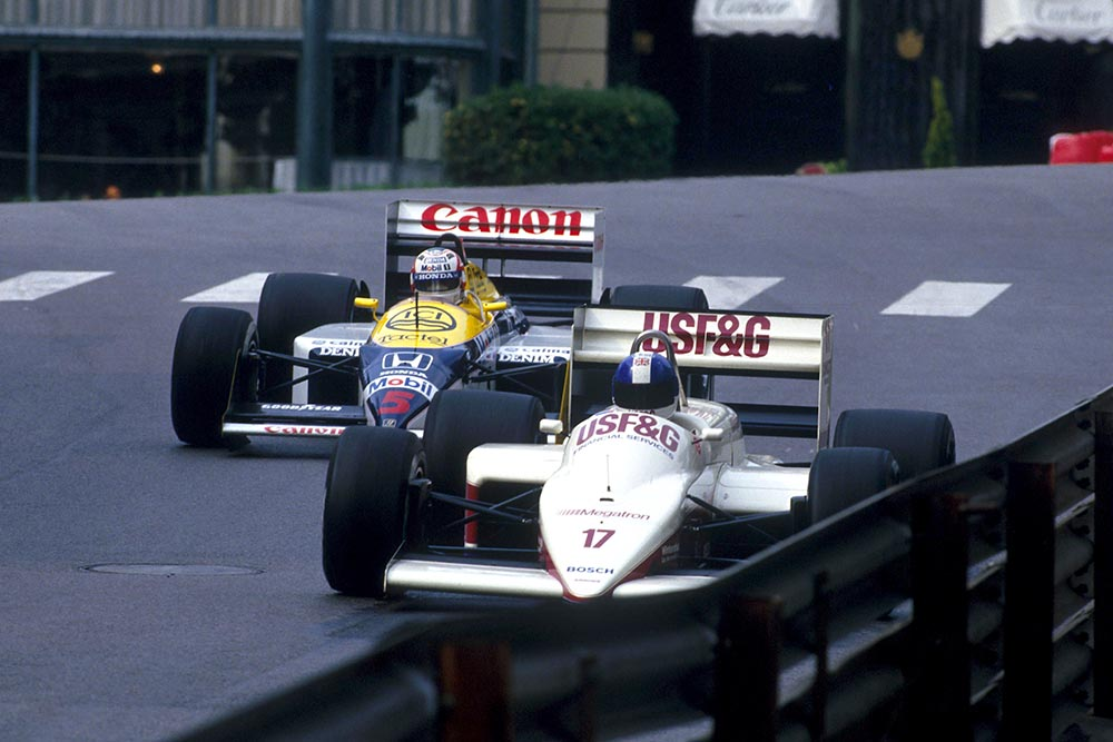Derek Warwick (Arrows A10) leads Nigel Mansell at Casino Square.