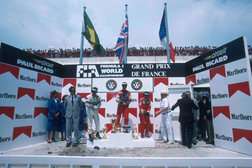Winner Nigel Mansell, Nelson Piquet 2nd and Alain Prost 3rd on the podium.