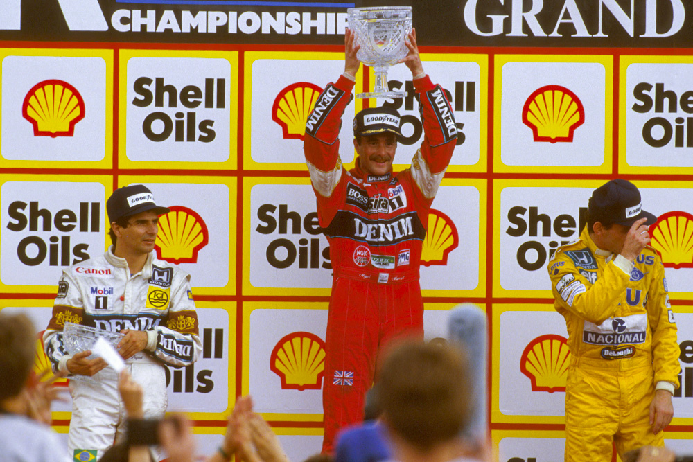 Nigel Mansell, 1st position, Nelson Piquet, 2nd, and Ayrton Senna, 3rd on the podium.