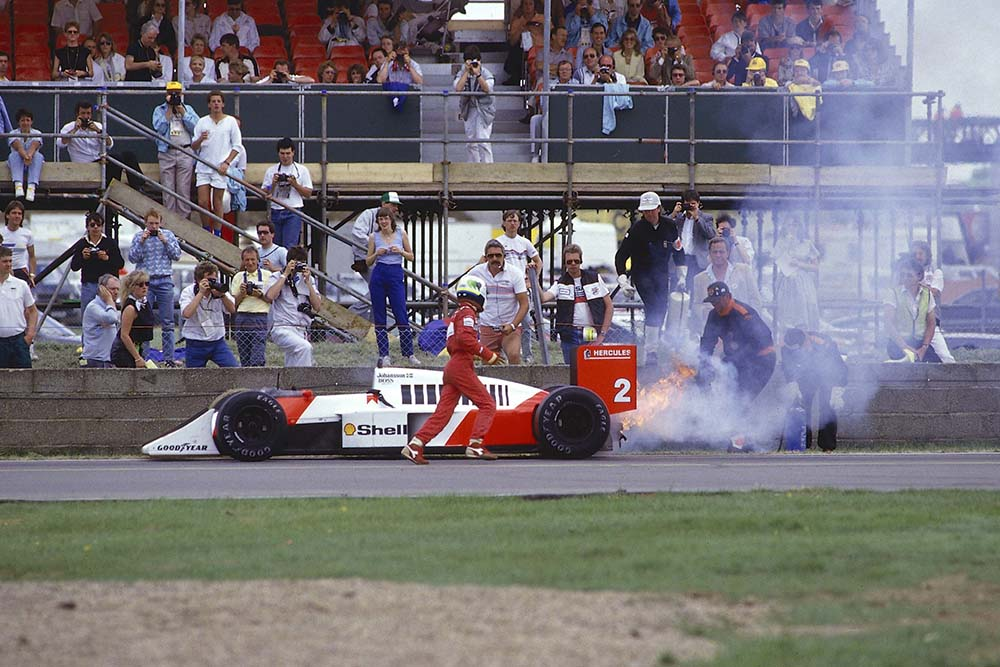 Stefan Johansson retires from the race after an engine failure caused his McLaren MP4/3 TAG Porsche to catch fire.