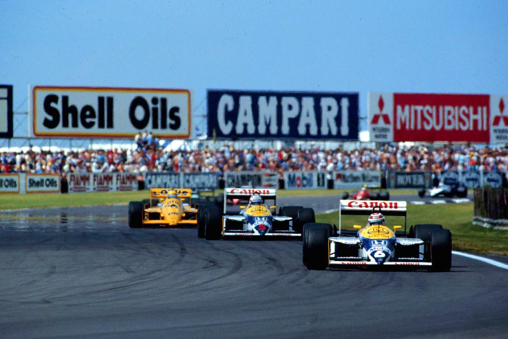 Nelson Piquet leads team mate Nigel Mansell and Ayrton Senna at the start of the race.