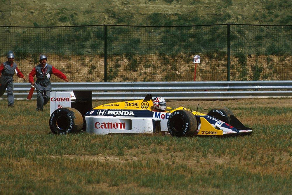 Nigel Mansell (Williams FW11B) retired from the lead of the race when the right rear wheel nut fell off on lap 70.