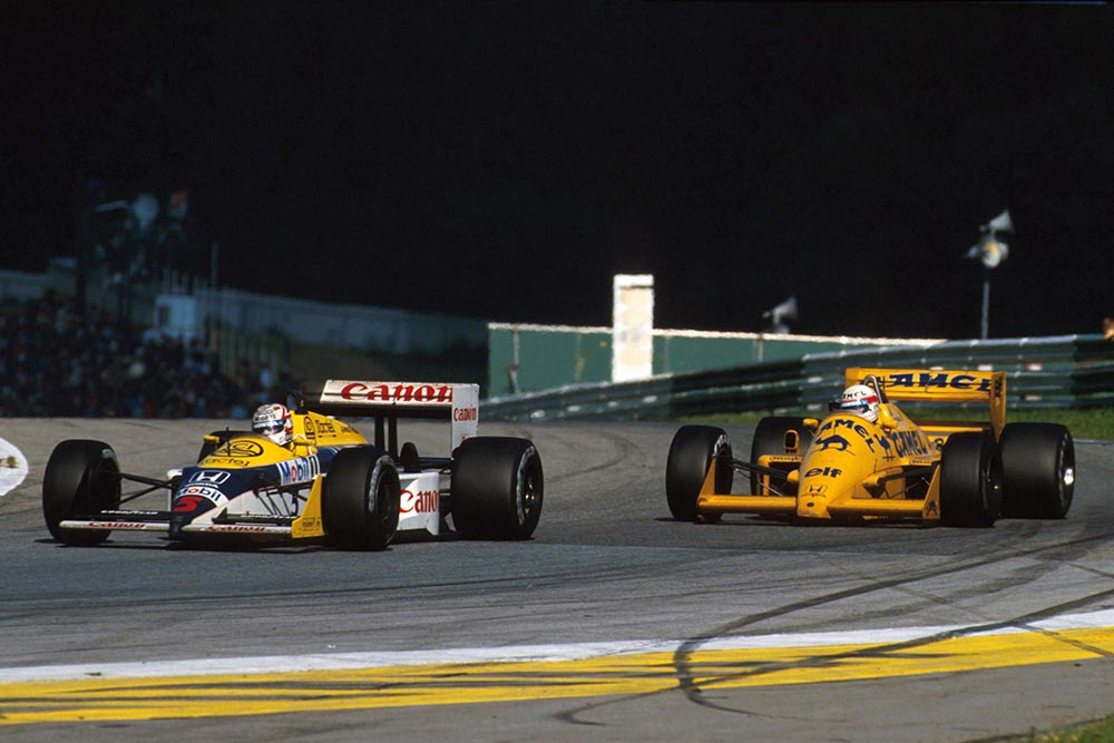 Nigel Mansell driving his Williams FW11B.