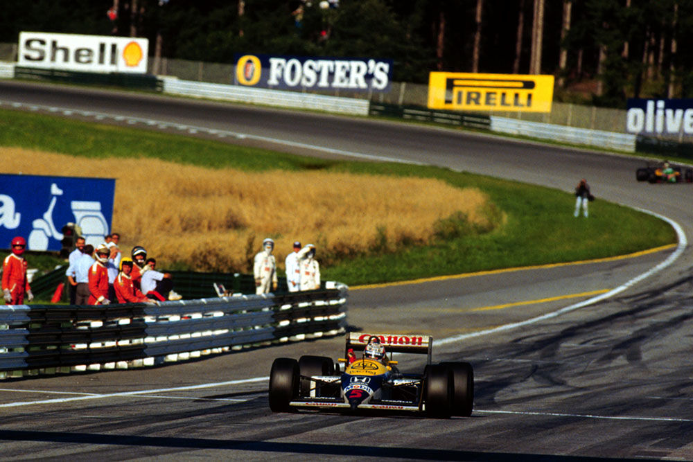 Nigel Mansell, raises his arm in victory at the Osterreichring.
