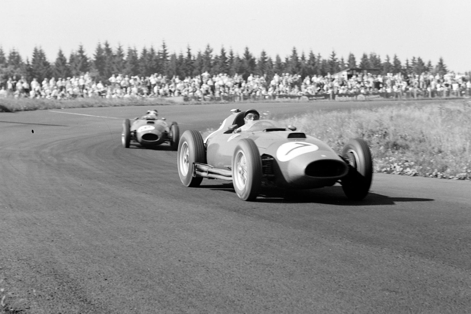Peter Collins, Ferrari D50, leads Mike Hawthorn, Ferrari D50 at the 1957 German Grand Prix, Nurburgring.