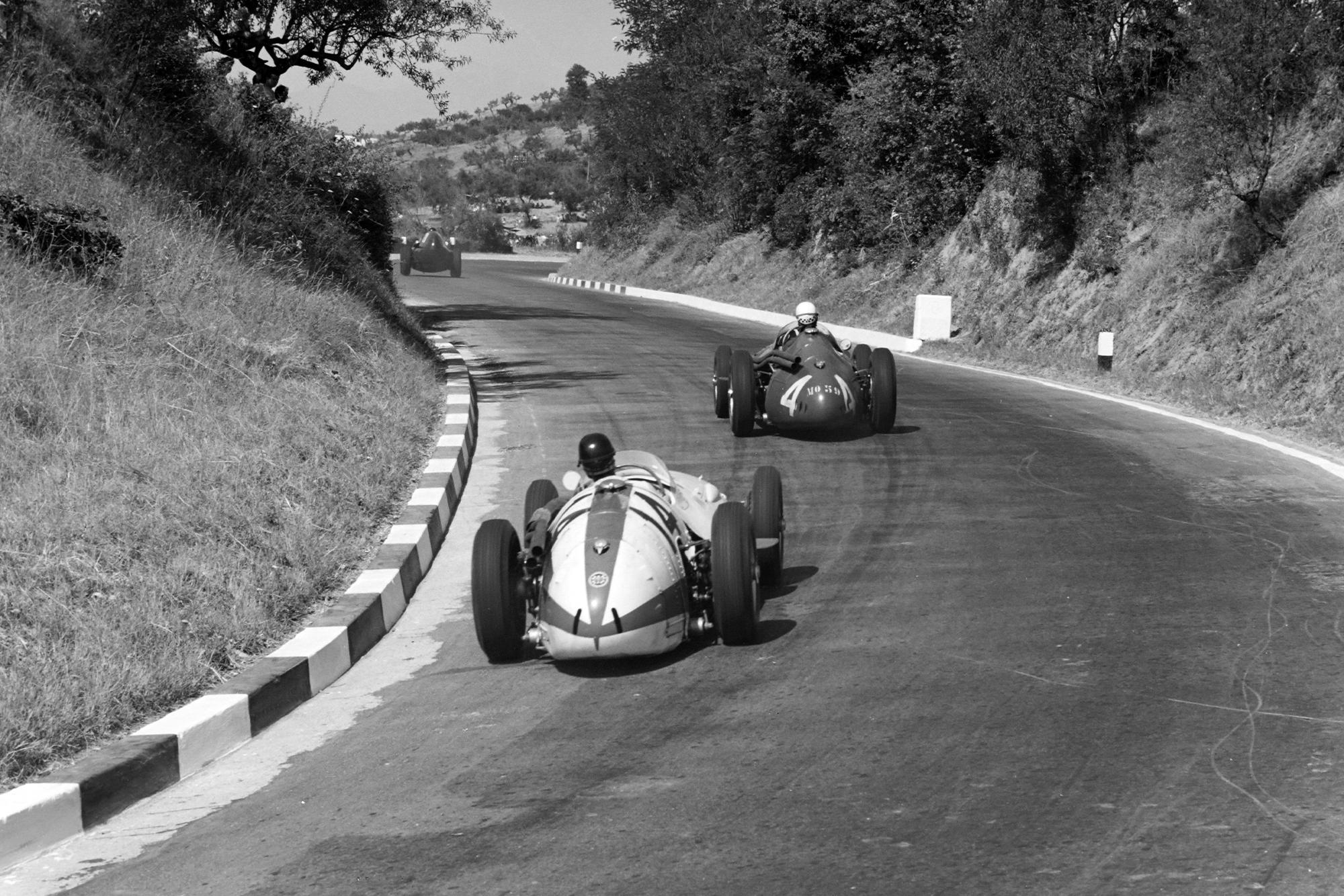 Tony Brooks, Vanwall, leads Jean Behra, Maserati 250F, and Masten Gregory, Maserati 250F, 1957 Pescara GP