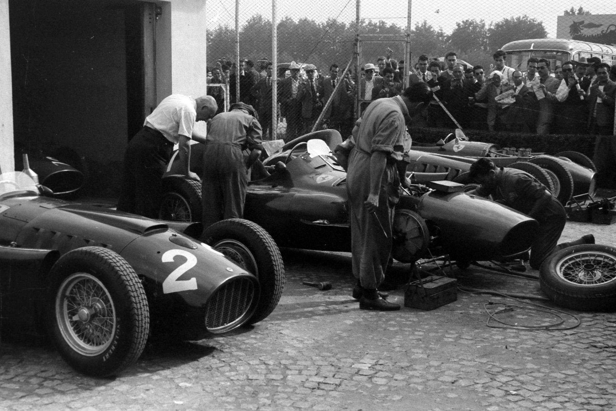 Ferraris are prepared in the pits