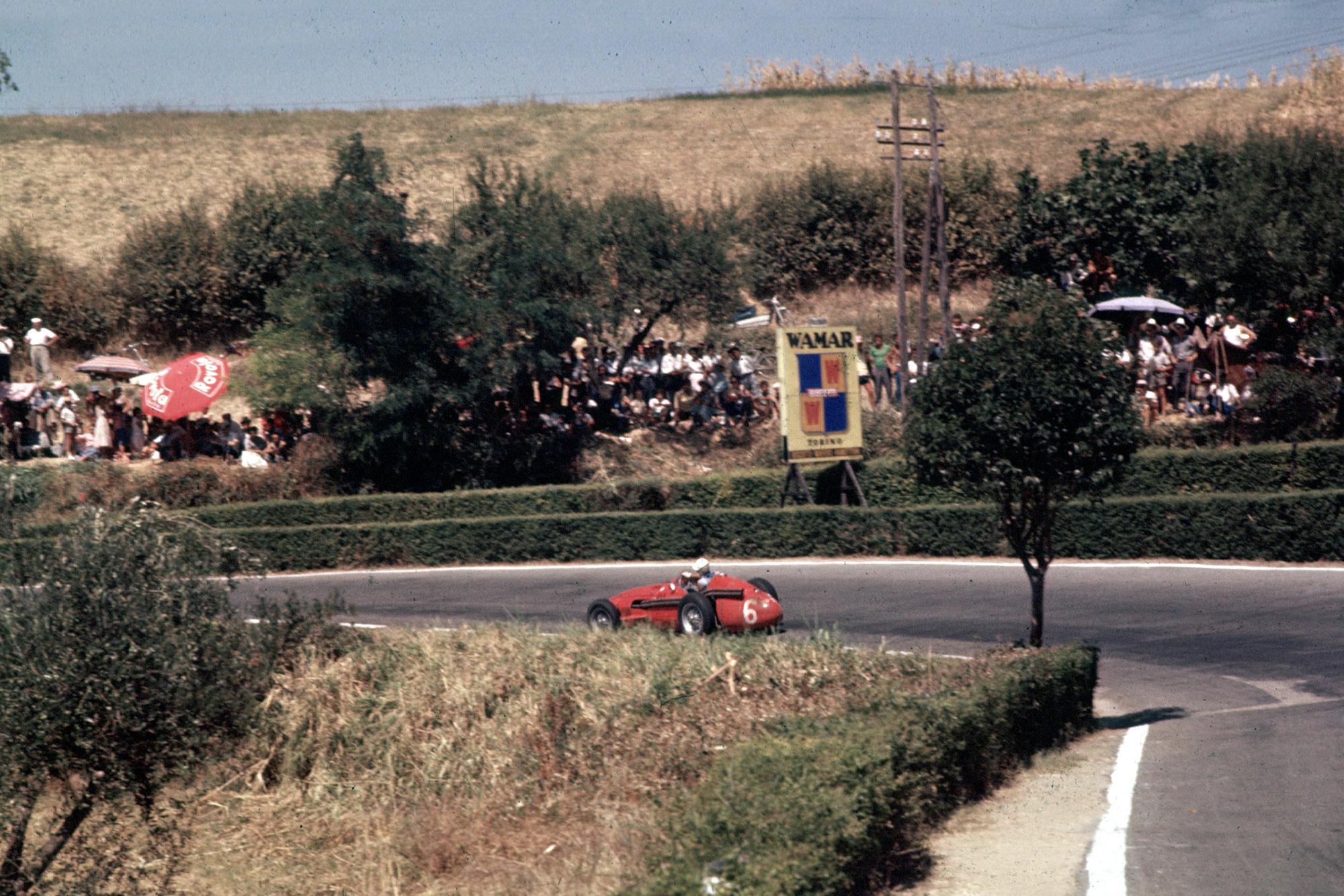 harry Schell rides down the hill in his Maserati 250F, 1957 Pescara Grand Prix