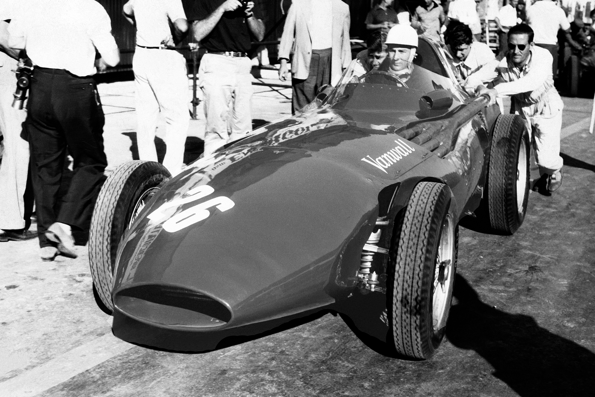 Stirling Moss's Vanwall is pushed out of the pits during the 1957 Pescara Grand Prix
