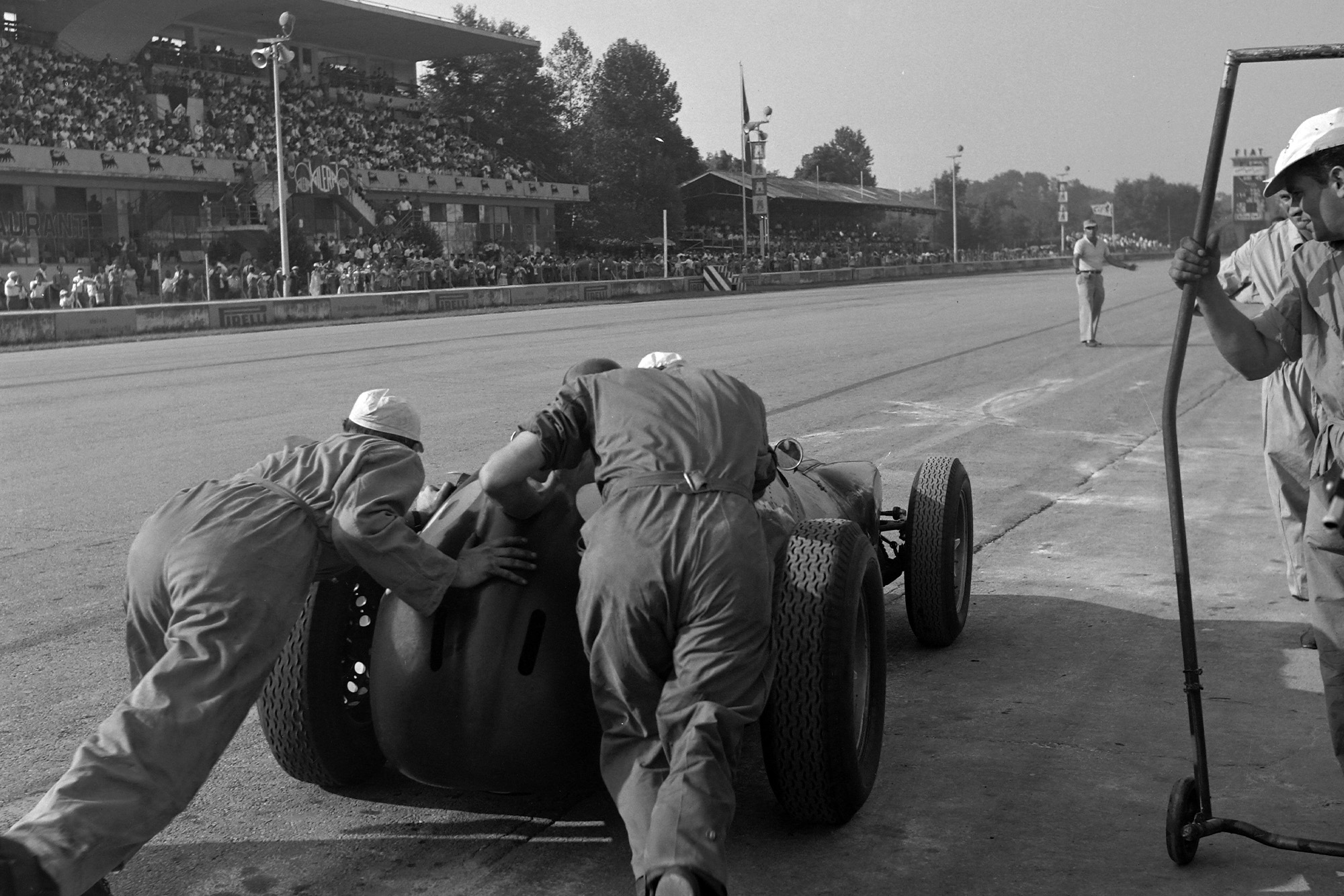 Behra gets a push out of the pits